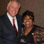 Corliss Udoema with Governor Terry McAuliffe